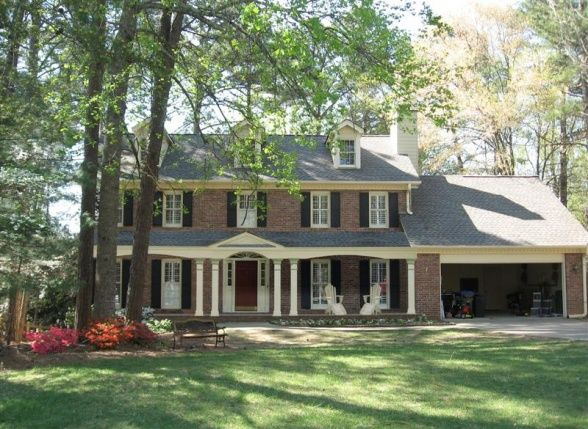 Lovely front porch addition to colonial dream home for Colonial house plans with porch