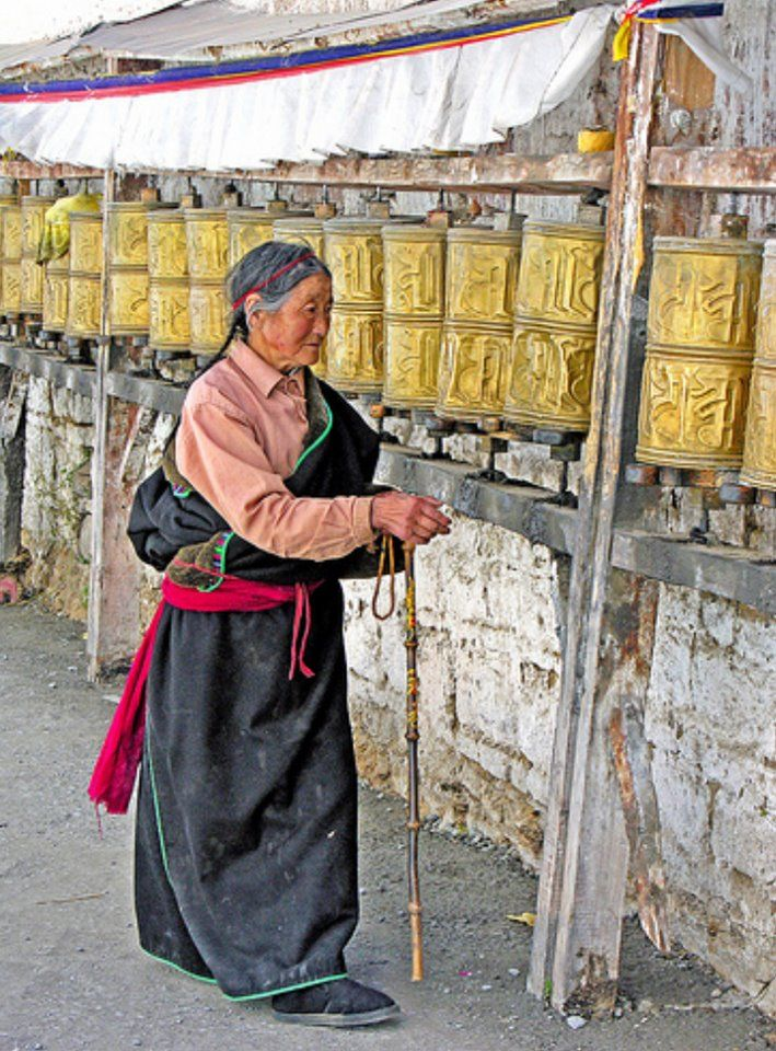 Spinning the prayer wheels near the exit of the Potala Palace.  Lhasa, Tibet