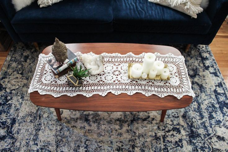 boho coffee table decor with crochet runner, candles, and Lulu & Georgia rug, interior design, blue pattern rug, home decor