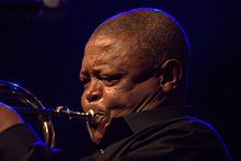 "Hugh Ramopolo Masekela (born April 4, 1939) is a South African trumpeter, flugelhornist, cornetist, composer, and singer... . He had hits in the United States with the pop jazz tunes ""Up, Up and Away"" (1967) and the number one smash ""Grazing in the Grass"" (1968), which sold four million copies.[4] He also appeared at the Monterey Pop Festival in 1967, and was subsequently featured in the film Monterey Pop by D. A. Pennebaker... ."