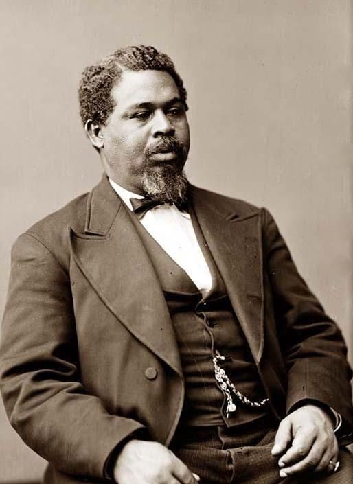 """This is a photograph of Robert Smalls, S.C. M.C. Born in Beaufort, SC, April 1839. Robert was a southern Slave, used by his owners to pilot the Confederate Ship """"Planter"""". In 1862, in the middle of the Civil War, Mr. Smalls organized a mutiny, stole the Planter, ran the blockade, and then turned the ship over to Northern authorities. Smalls was hailed as a National Hero, and was given prize money by the Congress and President Lincln. This photo was made in 1870."""