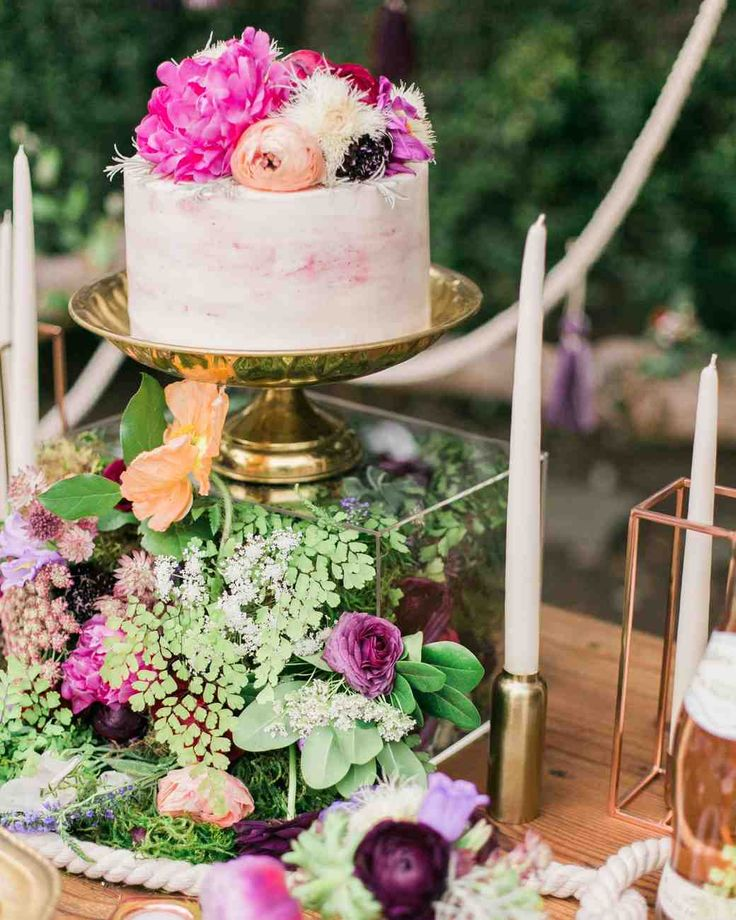 "You'll Want to Pin Every Detail of This Boho-Chic Bachelorette Party | Martha Stewart Weddings -""We decided to 'think outside the box' (pun intended!) for the florals, which spilled out of clear acrylic boxes and gave guests a 365-degree view of lush greens and flowers [by florist Iris & Daughter],"" Laurén said. ""Iris & Daughter did an amazing job bringing that vision to life."" Copper and gold candleholders and vases infused the boho-chic theme with a bit of glamour."