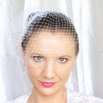 Lovely white birdcage veil made of 9 inch french netting. Simple yet elegant and perfect for how summer weddings or as the finishing touch for the no-nonsense modern bride. Attached to a 2 inch silver metal comb for easy wear. Veil can be worn at either side of the head or the front. Instructions on how to wear your birdcage veil are...