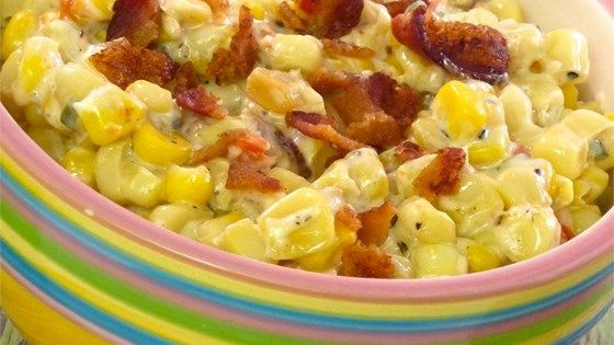 Corn is simmered in a creamy bacon sauce in the the slow cooker for a make-ahead side dish perfect for weeknights.