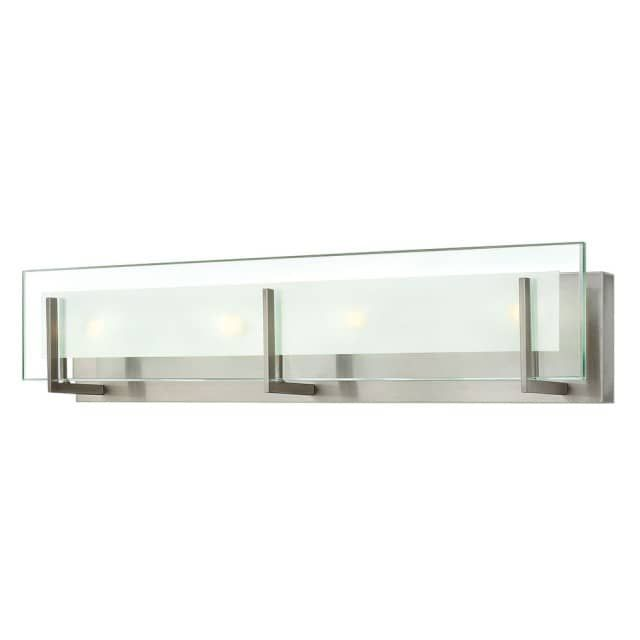 "The Latitude 4 Light Bath by Hinkley Lighting captures an appeal as illuminated poetry. Latitude is contemporary and sleek, finding its true beauty in the minimalist design. The slim glass panel features rectangular etching while the subtle, split fork frames add understated architectural style. The Latitude 4 Light Bath has a selection of finishes that blend with any decor. Enjoy the transformation in style and mood with the Latitude 4 Light Bath.  26"" Width x 5.75"" Height 4 X 60W G-9…"