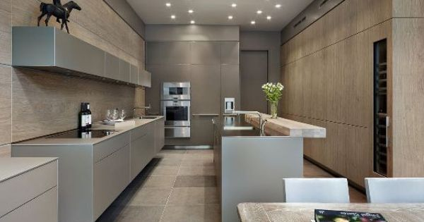 gorgeous pale blonde wood stone and taupe kitchen - Grand Dining Bulthaup by Kitchen Architecture