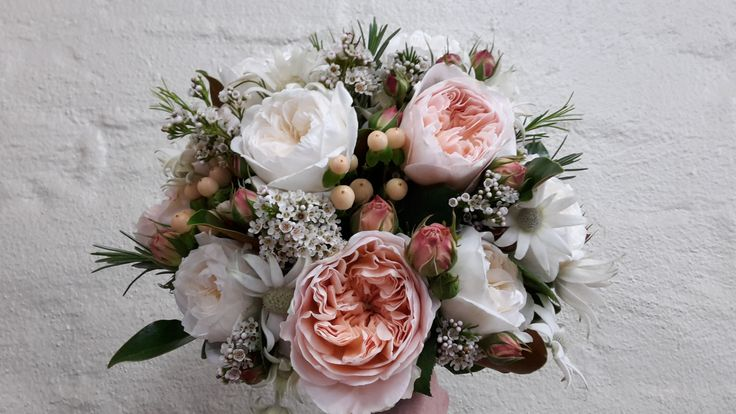 Rustic bouquet of David Austin roses, hypericum, flannel flower and herbs.