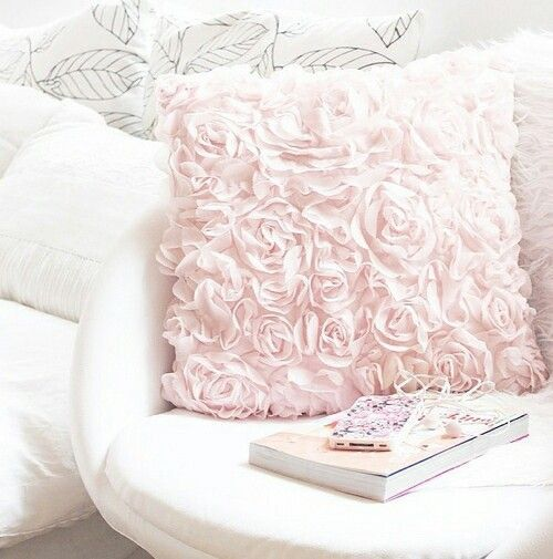 Keep your living room pretty in pink this #ValentinesDay with soft pink throw pillows. Bonus points for a flirty rose pattern!