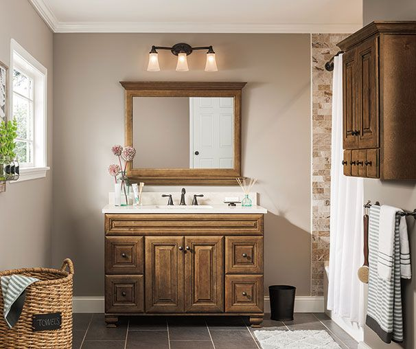the warm brown finish raised center panel and detailed profiling of beautiful ballantyne create a timeless bath the matching wall cabinet