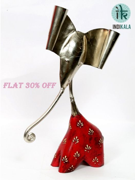 This figure of Ganesh Ji is believed to enhance positive vibes in its surroundings. An auspicous entry to your home décor collection.  special Offer on ganesh chaturthi flat 30% off! @www.indikala.com