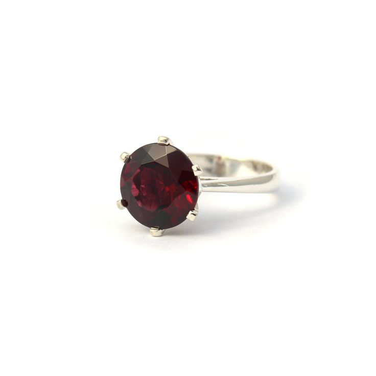 ENCHANTED CROWN RING SILVER AND RHODOLITE GARNET | Handmade from sterling silver this stunning cocktail ring is set a 10mm Rhodolite garnet.