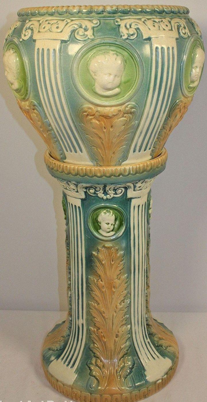 Roseville Pottery Cameo Cherub Jardiniere and Pedestal.