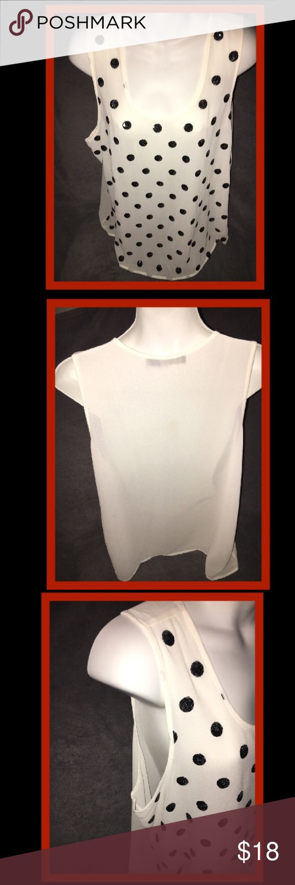 Limited Top A beautiful sheer top in a women's size extra large from the clothing line The Limited it's solid white with black sequence circles all over it it's a 100% polyester so it's soft comfortable and lightweight and it comes from a smoke and pet free home The Limited Tops