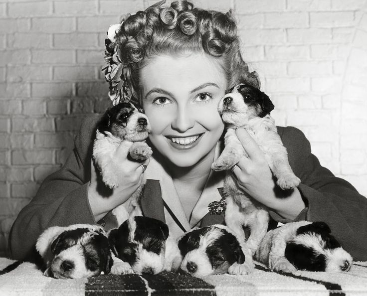 Joan Leslie with puppies