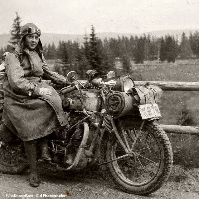 A young lady with a big motorcycle, ...Sweden. Ive been looking to try to find out what sort of motorbike this is and I think it must be a bike called an Ardie, manufactured in Germany. The positioning of the front springs on the girder forks lead me to think this way. Probably a 500cc single with twin exhaust valves. Yes its a hand gear change which was common at the time.