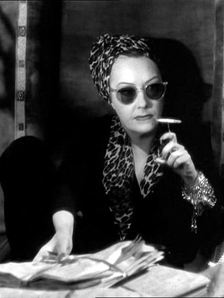 Gloria Swanson - Sunset Boulevard 1950 Her character Norma Desmond casually wears her favored leopard print scarf. The cigarette wire was to keep the fingers from staining from the nicotine, and there is someone in Torquay of all places selling replicas on etsy.