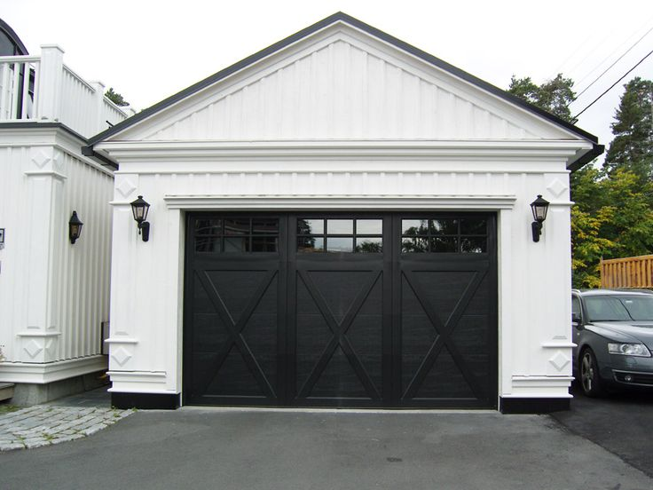 white garage with black x detail doors