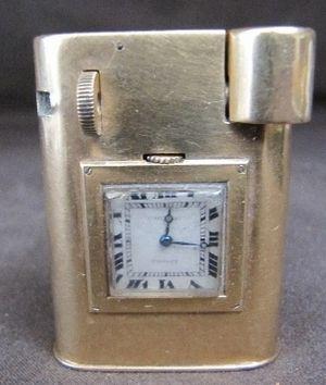 Antique Cartier gold watch lighter