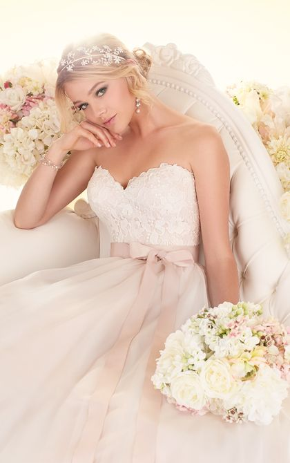 Essense of Australia ball gown wedding dress features a detachable beaded Tulle peplum to bring your wedding day a visual balance of classic and chic.