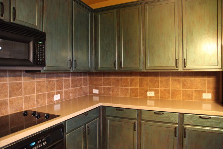 Kitchen, Furniture Fascinating Green Painted Kitchen Cabinet Beige Ceramic Tile Backsplash Bronze Cabinet Pull Handlers White Dimmer Switch Whirlpool Black Cabinet Oven Beige Wooden Laminate: Kitchen Cabinet Remodel Pictures