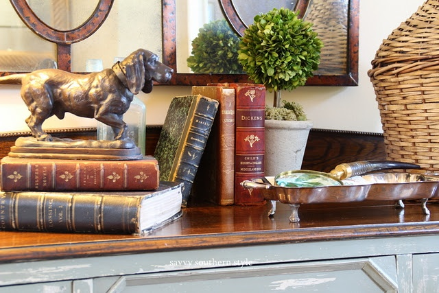 I like the way the books are placed and the topiary.