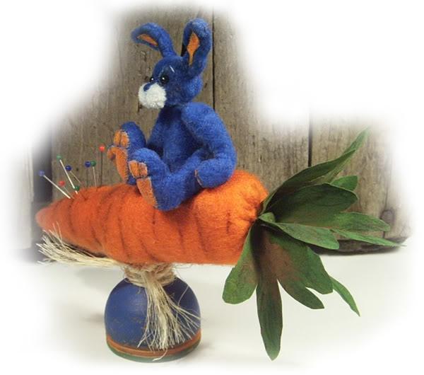 Miniature upholstery velvet rabbit on felt carrot pincushion, mounted on wooden egg cup make-do.
