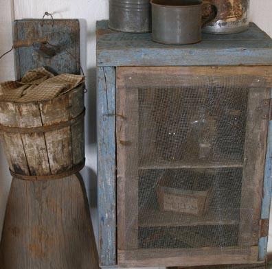 Close up of primitive blue cupboard we make and peg rack.