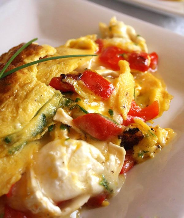 Goat Cheese, Sweet Pepper Omelet recipe | quick and healthy omelet recipe for evening dinners when we are rather short of ideas… get some farm eggs, goat cheese, red pepper, chives and parsley to make this very simple dish but rich in protein and calcium.