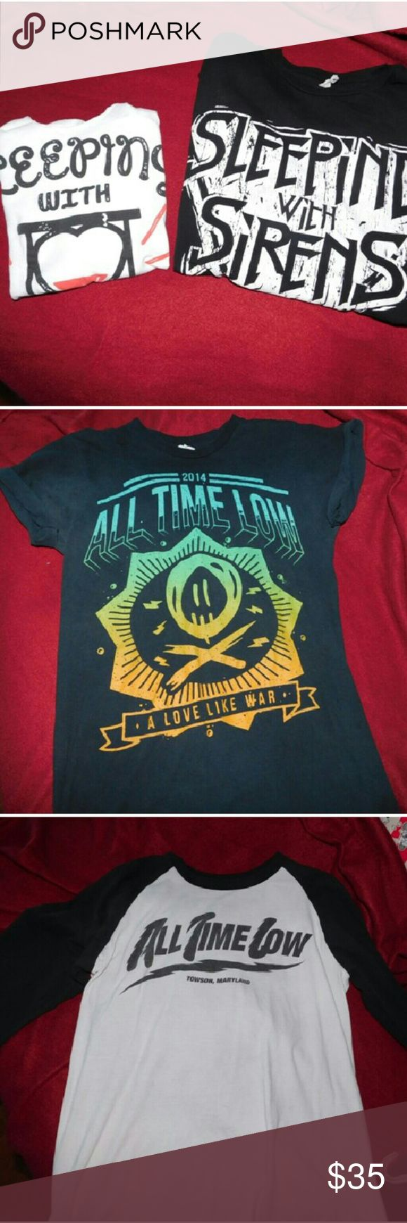 Band Shirt Bundle Sleeping with sirens all time lo Four band shirts. Two sws two atl. Women's size large sws tank. Men's medium black sws t shirt. Men's size medium atl baseball tee. Men's size medium atl black t shirt. Both atl shirts are very loved and worn so selling for very cheap alongside the ses shirts. Both sws shirts are in excellent condition. Barely worn at all. :) message me if you're interested Hot Topic Tops Tees - Short Sleeve