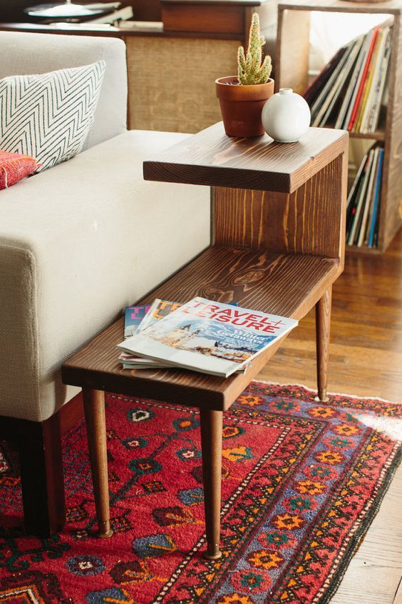 Tiered mid-century modern side table. Great idea for creating storage, from plants to magazines to remote controls. This looks like it could be an easy DIY project.