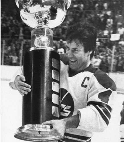 Winnipeg Jets captain Lars-Erik Sjoberg carries the Avco Cup after the Jets beat the Edmonton Oilers 7-3 to capture the final WHA championship four games to two in Winnipeg, May 20, 1979.