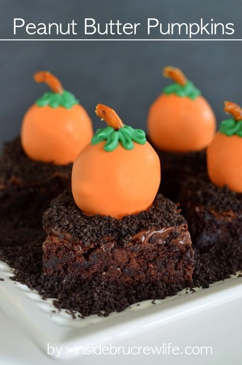Peanut Butter Pumpkins - peanut butter candy truffles rolled to look like pumpkins and dipped in orange candy melts