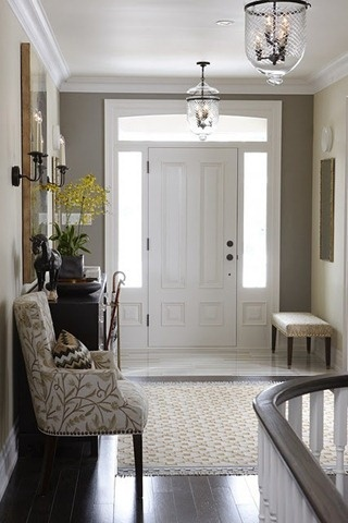 This is very similar to our entryway: the door with windows around it, the color scheme of the bench, flooring, rug, light fixtures, etc. the only change would be the inside color of the door (blue).