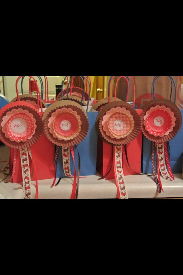 Rosettes for a horse themed party. Made from cupcake wrappers/ doilies and ribbon.