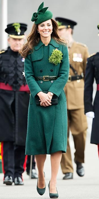 MARCH 17, 2014 Princess Kate celebrated St. Patrick's Day in head-to-toe green. At the Irish Guards parade in Aldershot, she handed out shamrocks in a Hobbs London coat which she accessorized with a Cartier shamrock brooch.
