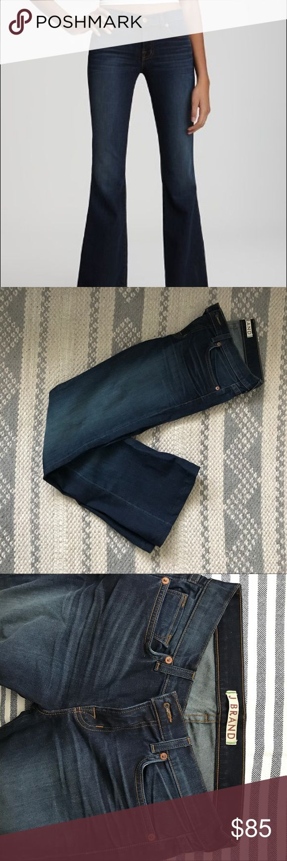 """J BRAND   Babe Classic Jeans An ultra-flattering shape defines stretch jeans fashioned with legs that flare to wide, flared hems below the knee break.    WAIST: 14"""" INSEAM: 28"""" (hemmed bottoms) Zip fly with button closure. Five-pocket style. Dark dye may transfer to lighter materials. J Brand Jeans Flare & Wide Leg"""