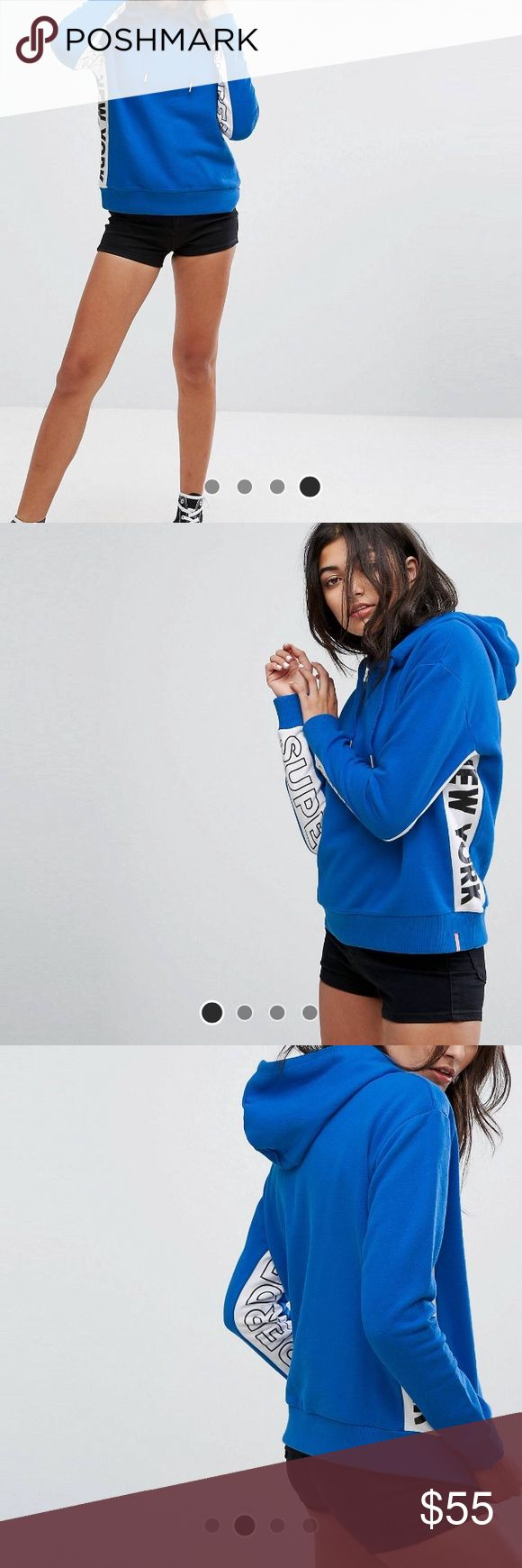 Superdry Hoodie with Taped Logo Sleeve Only worn once. Brand new! Super warm, cute and comfy! Beautiful bright blue color. Superdry Tops Sweatshirts & Hoodies