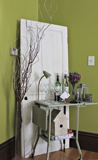 I could paint that old metal typing table and use it next to the loom or in the laundry room (remove those old wheels)