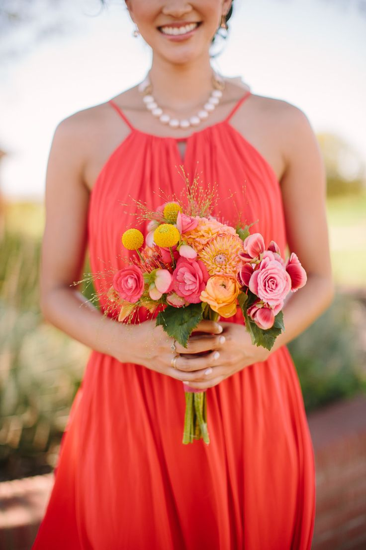 Pretty hues on the stunning maids | Read More: http://www.stylemepretty.com/california-weddings/2014/04/23/pink-orange-san-luis-obispo-wedding-at-windfall-farms/