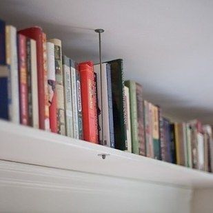 Hang shelves near the ceiling to draw the eye upward.   19 Foolproof Ways To Make A Small Space Feel So Much Bigger