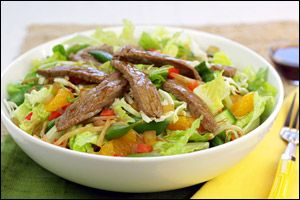 Hungry Girl: Big Beef-iyaki Salad  Entire recipe: 290 calories, 4.5g fat, 870mg sodium, 40g carbs, 8g fiber, 25g sugars, 26.5g protein -- PointsPlus® value 7* Teriyaki steak strips, mandarin oranges, and an amazing two-ingredient dressing... Dive in!