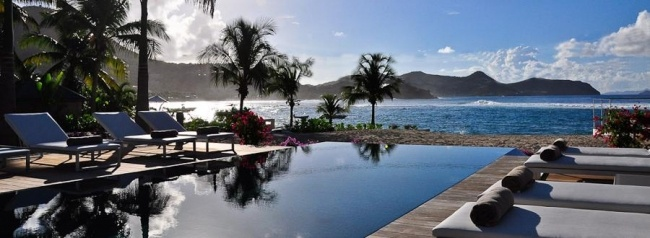 Palm Beach, St Barts Rental Villa, Lorient, St Barts, Premium Island Vacations. The heated infinity pool goes on in the ocean, and towards the horizon, and the beautiful scenery of the islands surrounding Saint Bart...To book: www.premiumislandvacations.com.