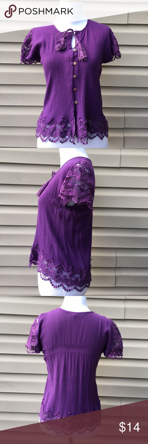"""TOBI women's purple short sleeve shirt Very nice purple button front top. Light gauzy material with crochet sleeves and hem, tassels tie at neck. No snags, stains, or holes. EUC 19""""W x 21""""L TOBI Tops Blouses"""