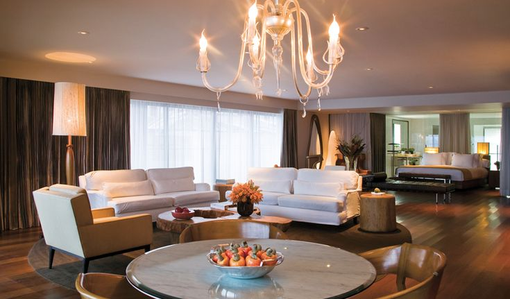 Luxurious suite in the Hotel Fasano, Rio de Janeiro. Check out the gossamer drapes.