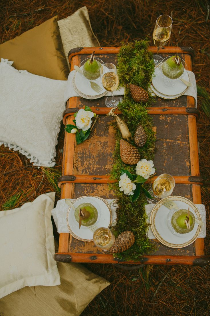 Rustic gold and green reception tablescape. Love the glittery pears and gold stag! Styled by Meant To Be