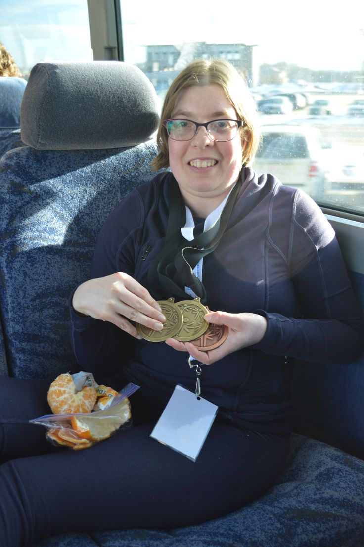 Cross country skier proudly showing off some medals!