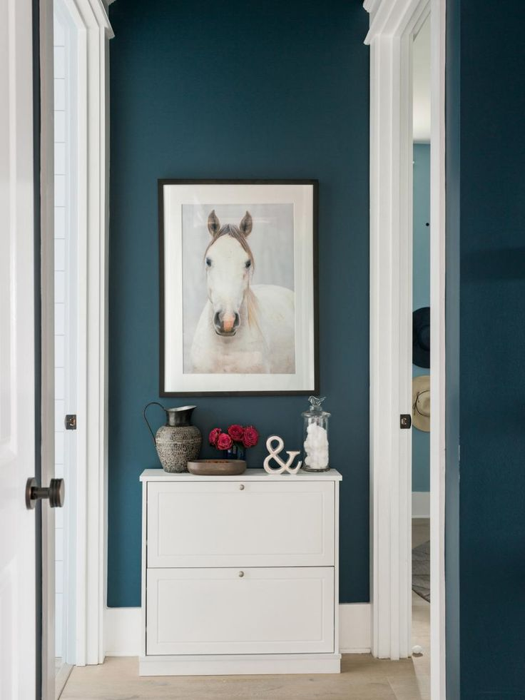 The well-detailed master closet with custom storage system, sophisticated furniture and light blue walls offers a functional and stylish way to get dressed every morning.