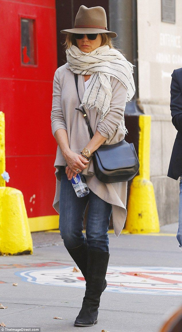 Not the Friend we know: The 46-year-old star opted for a causal look in jeans, knee-high boots and a long cream cardigan