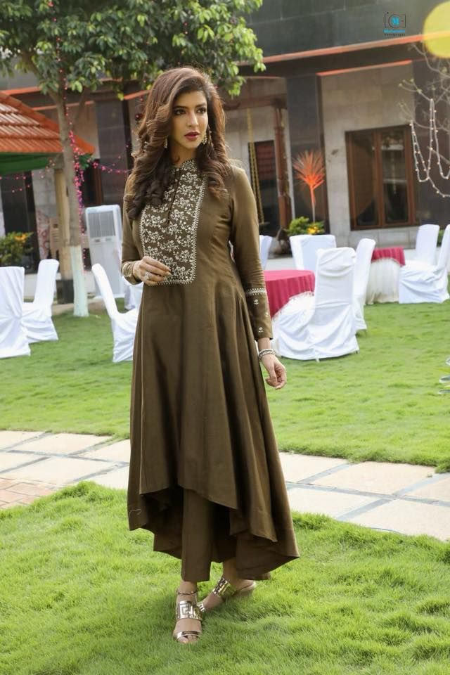 Lakshmi Manchu Way to glory in the perfectly styled tobacco brown outfit! Lakshmi manchi in asymmetric anarkali dress. in Ivory by Dipika and jewelry by Kalasha Fine Jewels .Hmu Manasa Makeup Artist Styled by Image Craft by Shweta Malpani. 28 March 2018