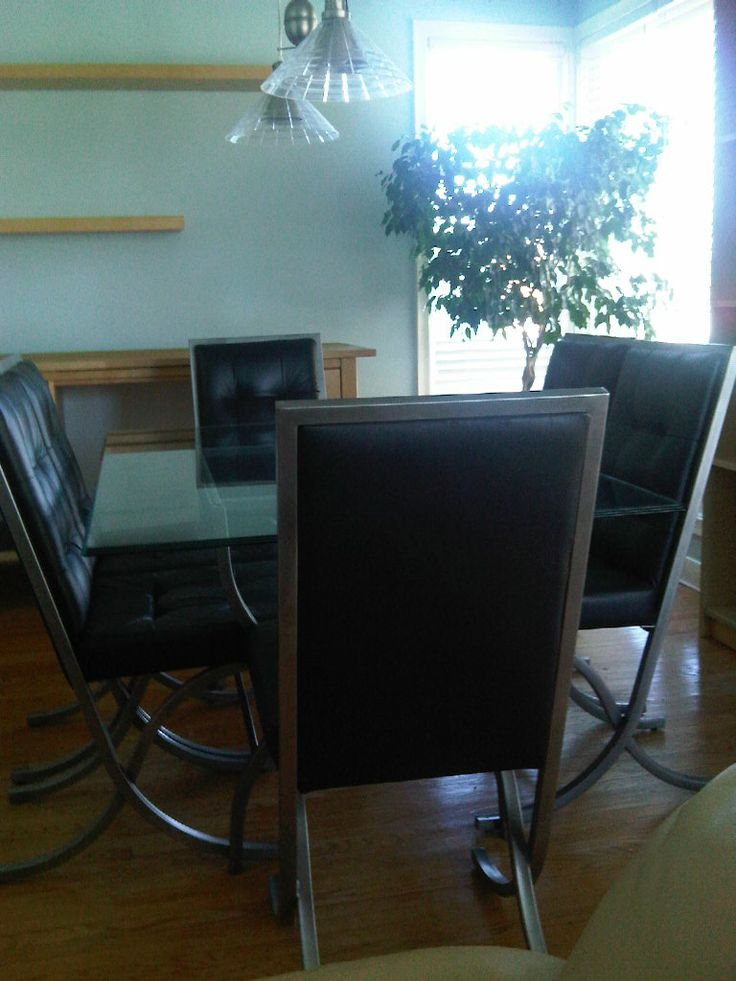 Dining set, Six leather chairs and glass table, mid century modern design, metal base and tufted leather seats. $1200 Item # DL-1001, In stock http://www.findandtreasure.com/catalogue.html